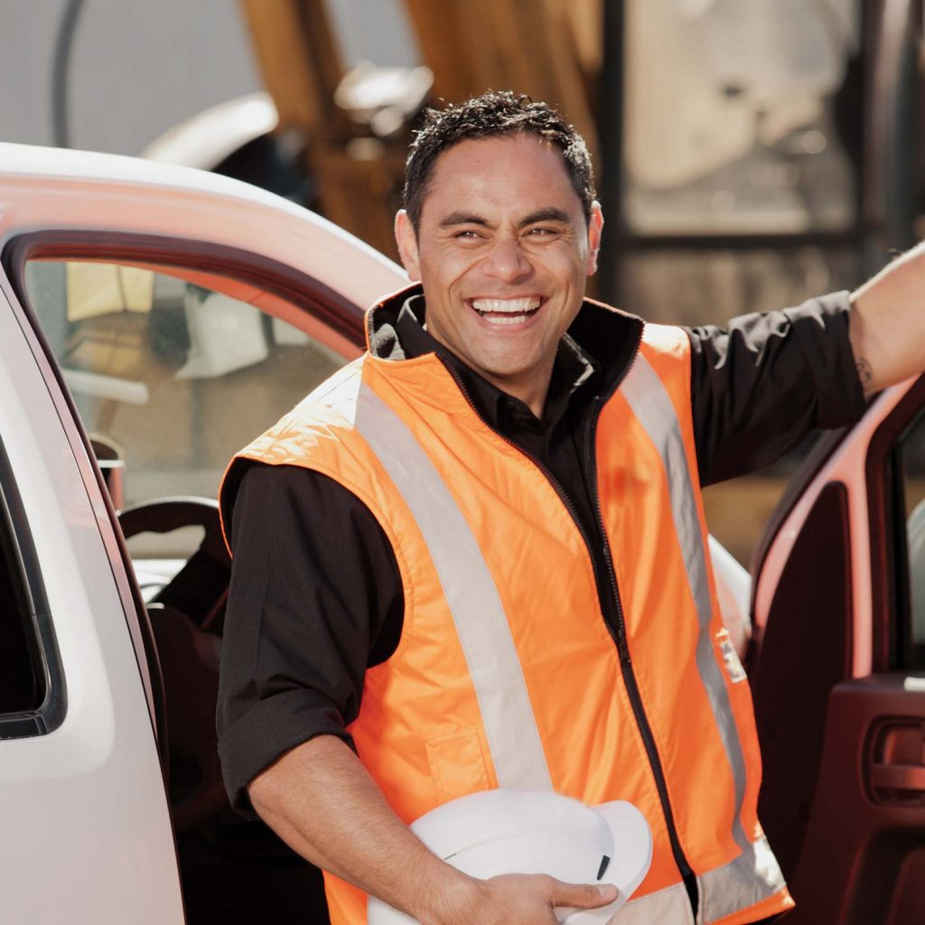 Photo of smiling YRCO worker stepping out of a ute