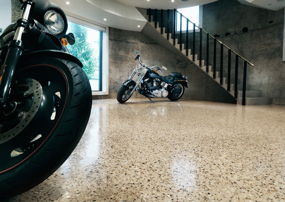 Motorbikes sitting on floor polished with Husqvarna HiPERFLOOR® polishing system